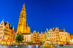 Antwerpen, Belgium. Night scene in downtown Antwerp, Belgium along the famous Meir Street and the lonely tower of the Cathedral of our Lady.