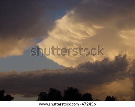 Anvil peeks through lower storm clouds