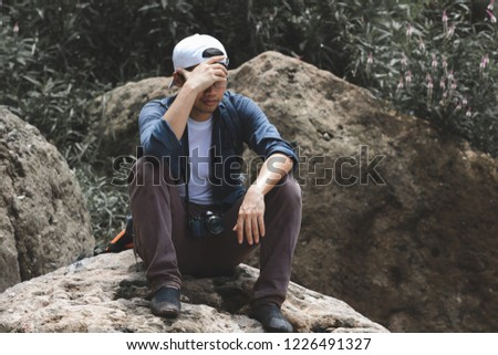 Anxiety stressed young Asian tourist man suffering from severe depression in nature. #1226491327