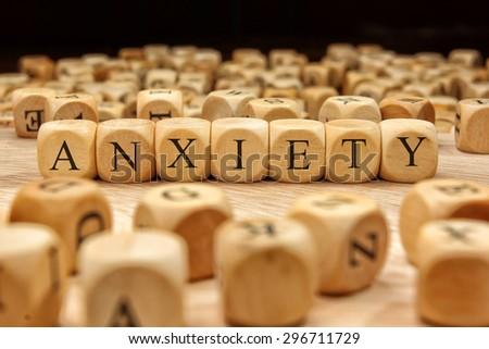 ANXIETY word written on wood block