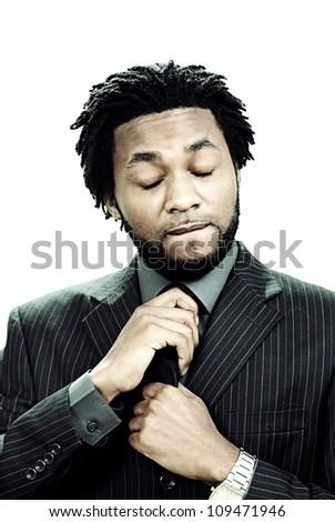 Anxious businessman adjusting his tie