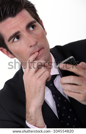 Anxious businessman with mobile phone