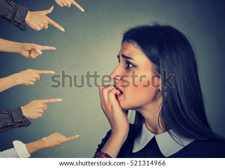 Anxious woman judged by different hands. Concept of accusation of guilty girl. Negative human emotions face expression feeling