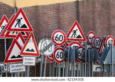 any traffic signs in front of the wall