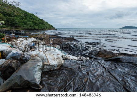 Ao Prao Beach was full of crude oil and dirty bag on oil spill accident on Ao Prao Beach at Samet island on July 31,2013 in Rayong,Thailand