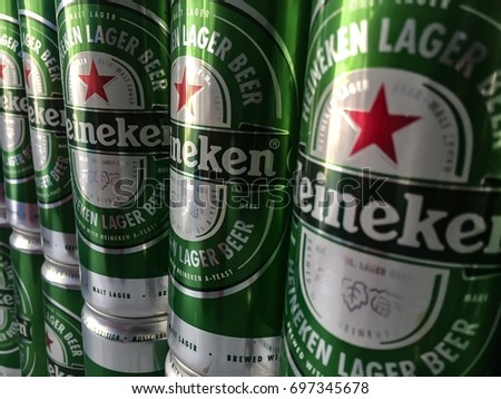 AO UDOM, CHONBURI, THAILAND - August 13,2017: Old Heineken beer cans were arranged as backdrops. By the wall.