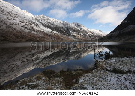 Aonach Eagach ridge reflected in Loch Achtriochtan in Glencoe is one of the most famous hillwalking challenges in Scotland.