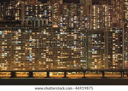 Apartment block at night, Hong, Kong - stock photo