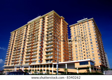 apartment block on the blue sky background