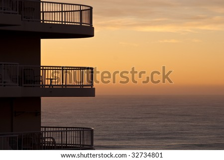 Apartment building balcony with sunset in the distance, in Surfers Paradise, Australia