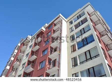 Apartment building.Multistoried modern and stylish living block of flats. Real estate. New house.Real Estate.