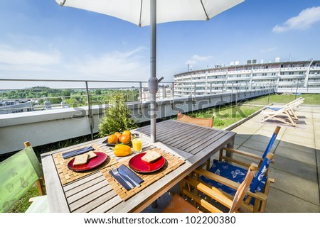 Apartment building roof top terrace exterior with fresh breakfast