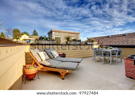 Apartment building roof top terrace exterior with modern living area.