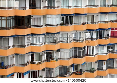 apartment building windows with balconies in mallorca