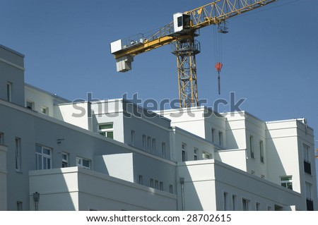 Apartment building with a crane in the background