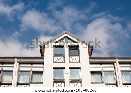Apartment building with a peak roof - stock photo