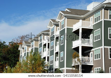 apartment building with spring trees landscape #1411058114