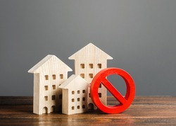 Apartment buildings and red prohibition symbol NO. Emergency and unsuitable for living building. Unavailable expensive housing. Lack of living space and the impossibility of building a new houses.