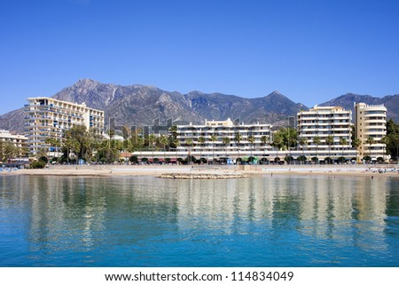 Apartment buildings by Mediterranean Sea in resort town of Marbella on Costa del Sol in Spain, Andalusia, Malaga province.