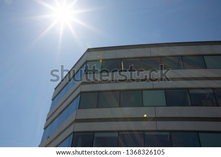 apartment buildings exteriors or Contemporary Architecture Office In sunny day City #1368326105