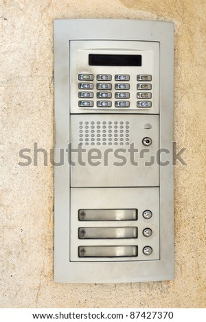 Apartment buzzers with push buttons and intercom