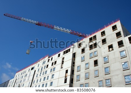 Apartment construction site with crane
