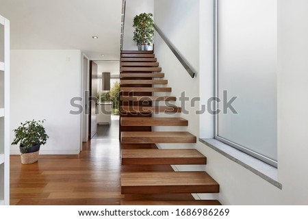 Apartment entrance hall with wooden staircase access to upper floor, design, furniture, home, modern, sea, wooden Сток-фото ©