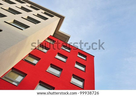 Apartment house, town building on blue sky