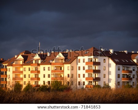 apartment house with dark clouds over