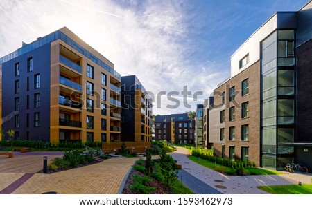Apartment in residential building exterior. Housing structure at blue modern house of Europe. Rental home in city district on summer. Wall and glass high architecture for business property investment. Foto stock ©