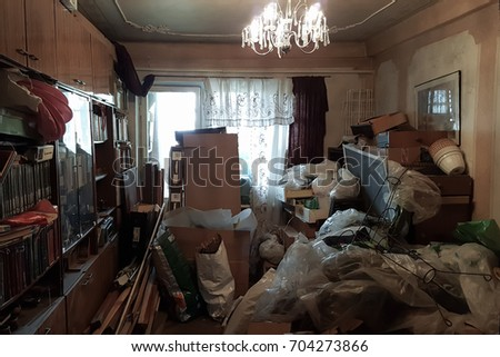 Apartment of a pensioner who suffers from compulsive hoarding, littered with trash and books ストックフォト ©