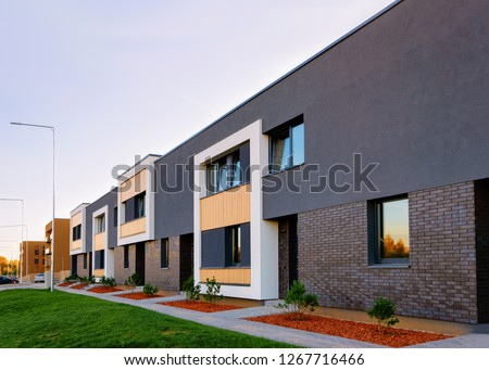 Apartment residential townhouses facade architecture with outdoor facilities. Blue sky on the background.
