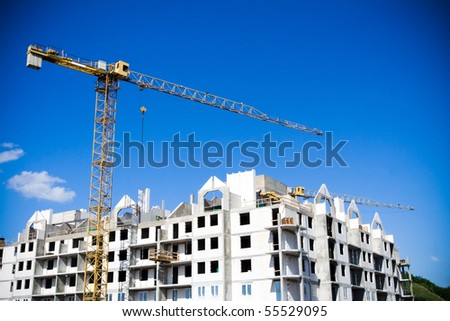 Apartments construction site with yellow crane