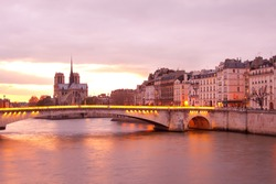 Apartments on Ile Saint Louis, Notre Dame Cathedral on Ile de la Cite and Pont de la Tournelle bridge over Seine river, Paris, France