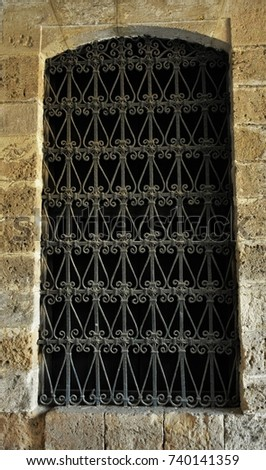 Aperture of the antique window with iron grating  #740141359