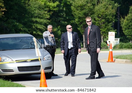 APEX, NC, USA - SEPTEMBER 14: Security checks the surroundings before President Barack Obama arrives at Westar company on September 14, 2011 in Apex, NC, USA