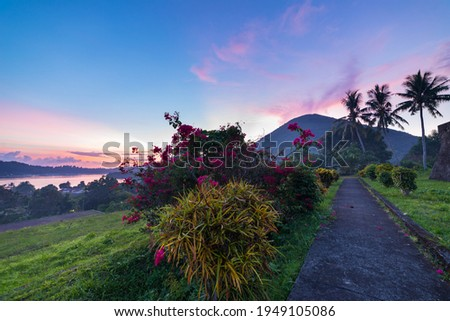 Api volcano at sunset, sitting at view from Banda Naira fort, Maluku Moluccas Indonesia, Top travel tourist destination, dramatic sky. Foto stock ©