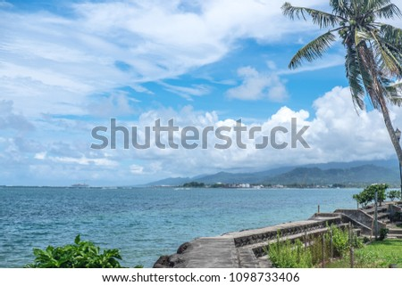 Apia harbour and waterfront, with commercial shipping port and container ship in background - Upolu Island, Western Samoa, South Pacific