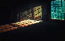 Apocalypse moonlight through the window glass into a dark room