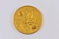 Apollo 11 commemorative coin on white background