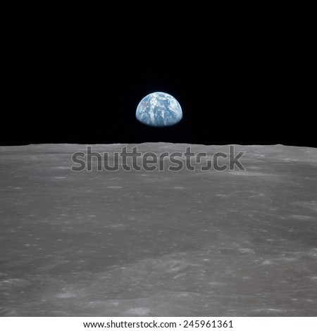Apollo 11 Earth rise over the Moon. Earth on the horizon in the Mare Smythii Region of the Moon. Image 5 of a NASA sequence of 18. July 20, 1969.