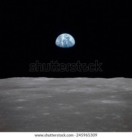 Apollo 11 Earth rise over the Moon. Earth on the horizon in the Mare Smythii Region of the Moon. Image 14 of a NASA sequence of 18. July 20, 1969.