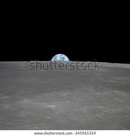 Apollo 11 Earth rise over the Moon. Earth on the horizon in the Mare Smythii Region of the Moon. Image 1 of a NASA sequence of 18. July 20, 1969.
