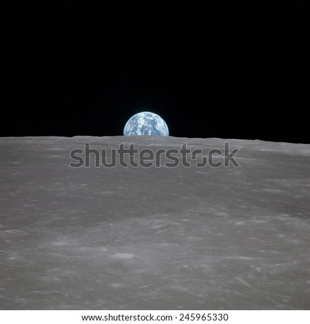 Apollo 11 Earth rise over the Moon. Earth on the horizon in the Mare Smythii Region of the Moon. Image 2 of a NASA sequence of 18. July 20, 1969.