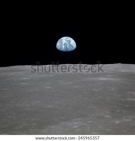 Apollo 11 Earth rise over the Moon. Earth on the horizon in the Mare Smythii Region of the Moon. Image 6 of a NASA sequence of 18. July 20, 1969.