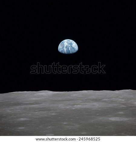 Apollo 11 Earth rise over the Moon. Earth on the horizon in the Mare Smythii Region of the Moon. Image 17 of a NASA sequence of 18. July 20, 1969.