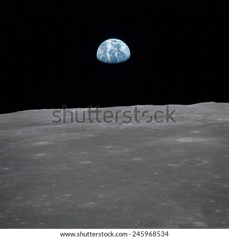 Apollo 11 Earth rise over the Moon. Earth on the horizon in the Mare Smythii Region of the Moon. Image 11 of a NASA sequence of 18. July 20, 1969.