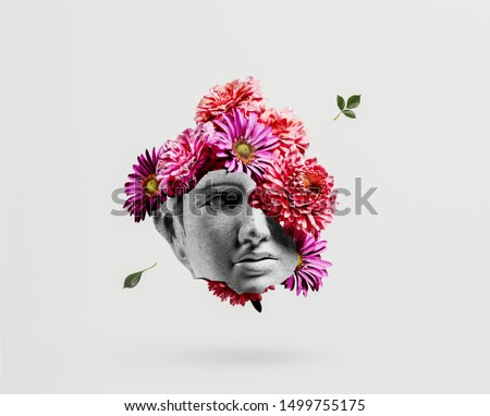 Photo of  Apollo head with flower background concept.