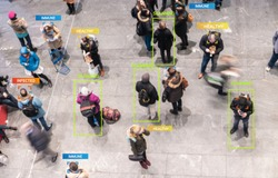 App scanning and tracking blurred people for Coronavirus prevention in city center - Software against Covid-19 outbreak - Big data, privacy and health concept - Defocused image with Icons