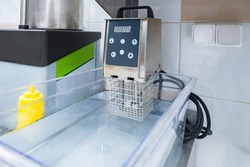 Apparatus for cooking dishes using sous vide technology. Sous vide equipment for restaurant. Sale of sous vide equipment. Kitchen equipment for professional chefs. Concept - cooking food in a vacuum